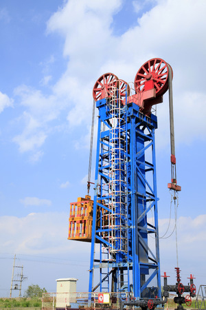 Tower type pumping unit under the blue sky photo