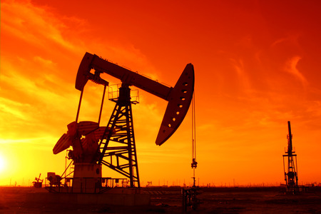 Oil field scene, beam pumping unit silhouette, very beautiful photo