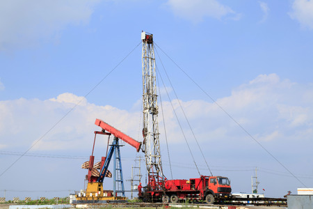 oilwell: Oil field scene,tower type pumping unit in the work