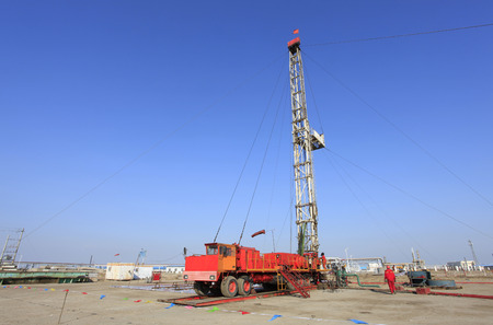 Oil field scene,tower type pumping unit in the work photo