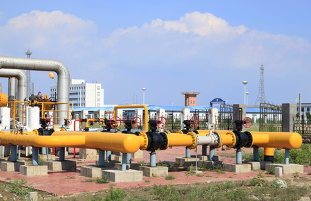 In oil field, there is oil pipeline and oilfield equipment at work photo