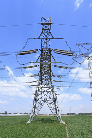 transformator: High voltage towers, under the blue sky white clouds, very beautiful Stock Photo