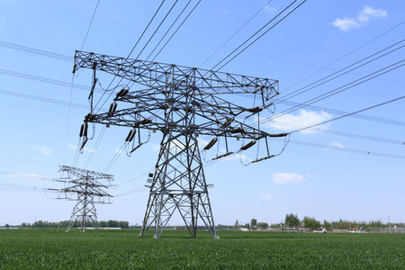 High voltage towers, under the blue sky white clouds, very beautiful photo