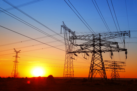 energy electrician: The evening of the pylon outline, is very beautiful Stock Photo