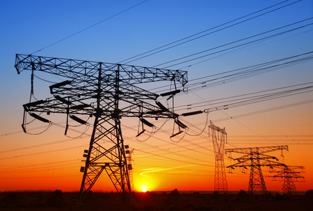 isolator high voltage: The evening of the pylon outline, is very beautiful Stock Photo