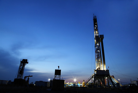 horsehead pump: The evening of oilfield derrick silhouette, it is very beautiful Stock Photo