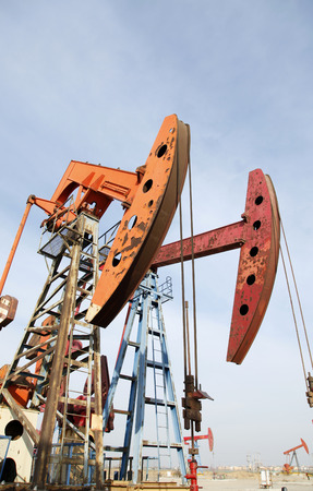 horsehead pump: Oil field, oil pump in the work Stock Photo