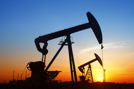 energy work: In the evening, the outline of the oil pump Stock Photo