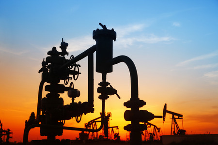 mineral oil: Oil field scene, Oil pipeline and pumping unit of the silhouette