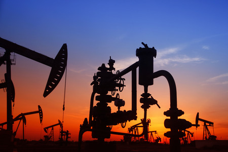 mineral oil: silhouette of the oil pump during sunset