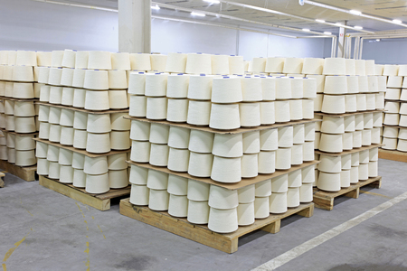 semifinished: The textile workshop, spool piled up together, neat rows