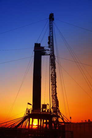 oilwell: In the evening, the silhouette of oilfield derrick