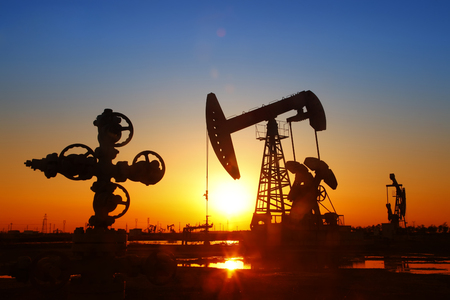 a power: Oil field scene, Oil pipeline and pumping unit of the silhouette