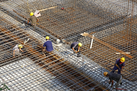 worker in the construction site making reinforcement metal framework for concrete pouring Stock Photo