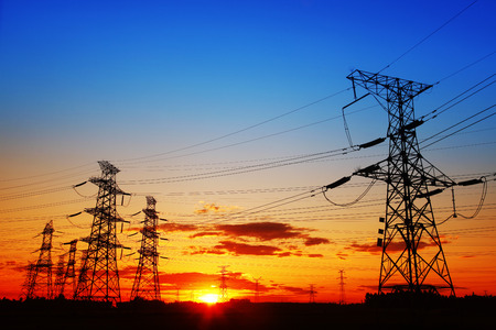 electric line: The evening of the pylon outline, is very beautiful Stock Photo
