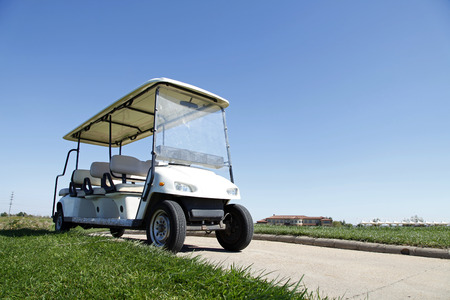 White golf carts at the green golf course