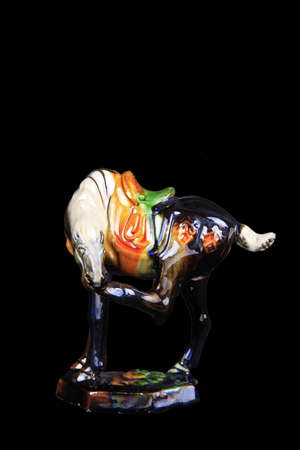 tricoloured: tri-coloured glazed pottery horse of the Tang Dynasty.