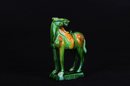 dynasty: tri-coloured glazed pottery horse of the Tang Dynasty Editorial