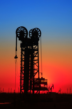 mechanical works: The silhouette of tower type pumping unit Stock Photo