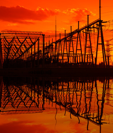 electrical tower: The silhouette of the evening high voltage substations