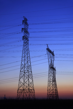 power lines: The evening of the pylon outline Stock Photo