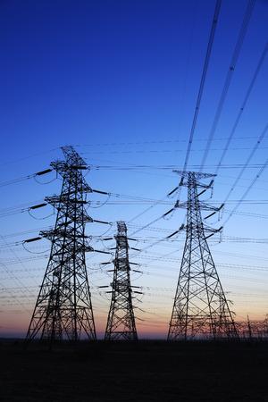 transformator: The evening of the pylon outline Stock Photo