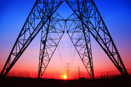 transformator: The silhouette of high voltage towers
