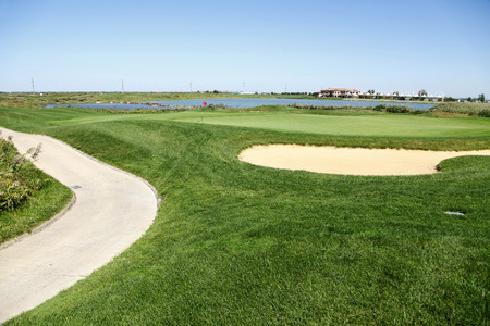 bunker: Sand bunker on the golf course
