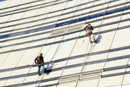 steeplejack: Workers wash the modern office building