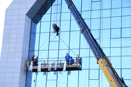 work worker: Workers wash the modern office building