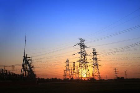 isolator: The silhouette of the evening electricity transmission pylon