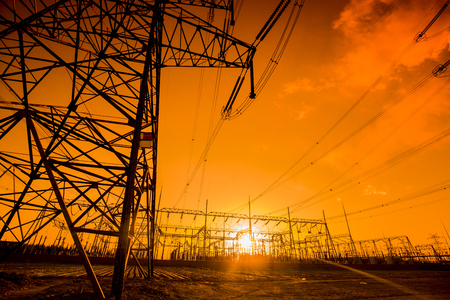 transformator: The silhouette of the evening electricity transmission pylon