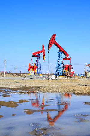 mechanical works: Oil field, oil pump in the work Stock Photo
