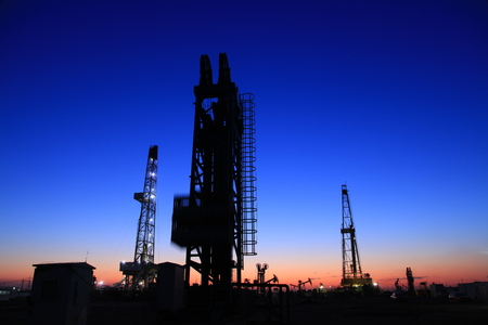 oilwell: In the evening of oilfield derrick