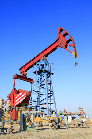 mechanical works: Oil field, oil pump in the work Editorial