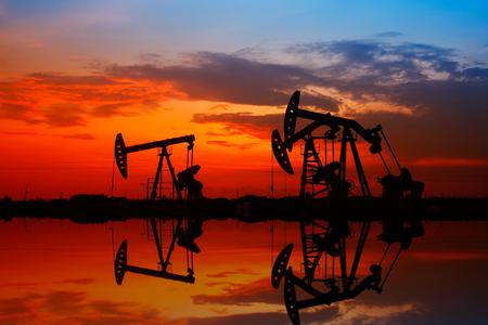 nodding: Oil field scene, Oil pipeline and pumping unit of the silhouette