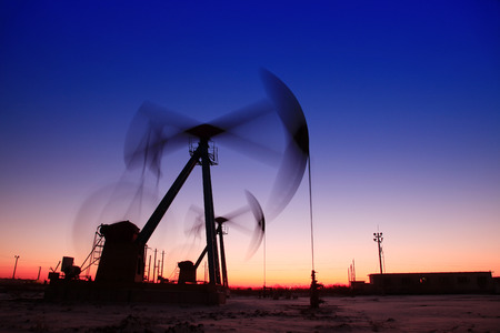mechanical works: In the evening, the outline of the oil pump Stock Photo