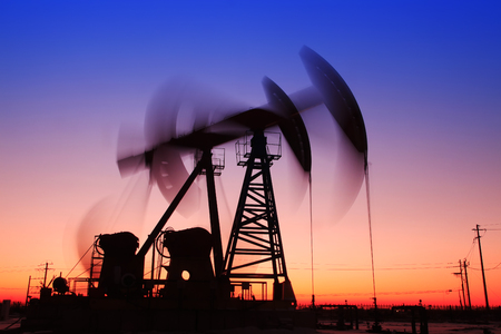 In the evening, the outline of the oil pump Stock Photo
