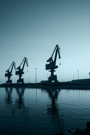 gantry: In the evening, gantry crane at the dock