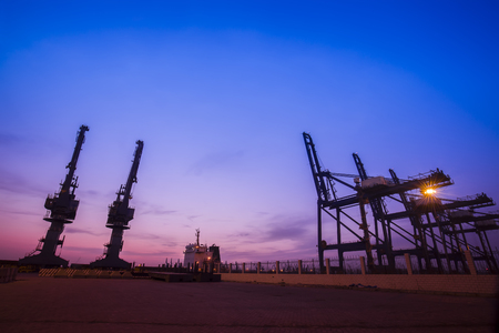Cargo port in the evening, The silhouette of gantry crane