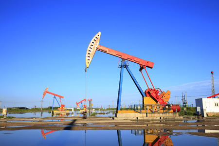 Oil field, oil pump in the work Stock Photo
