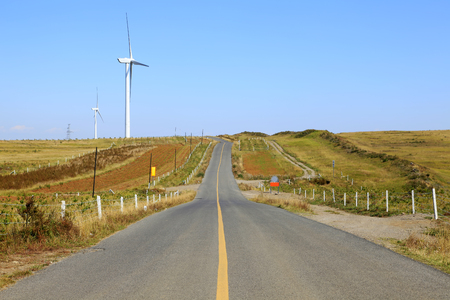 windpower: Asphalt road and wind turbines
