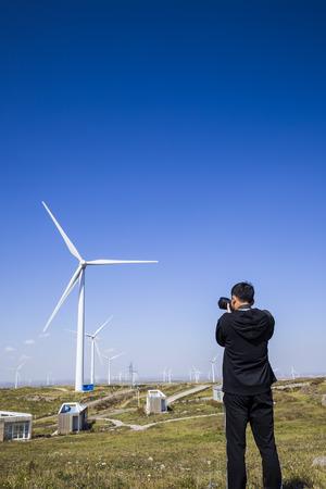 A photographer shoot wind turbines