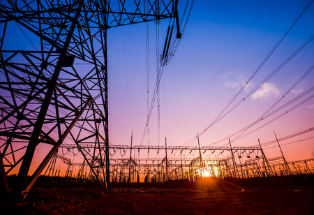 transmit: The silhouette of the evening electricity transmission pylon