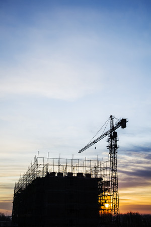 unfinished building: Construction site in the evening