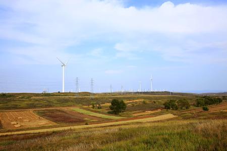 Autumn terraces and wind turbines