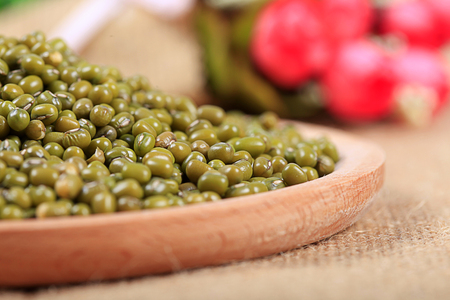 mung beans on a wooden plate close up view