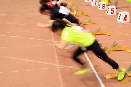 athletics with sprint start Stock Photo