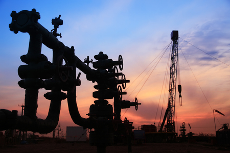 In the evening of oilfield pipeline silhouette landscape view Stock Photo