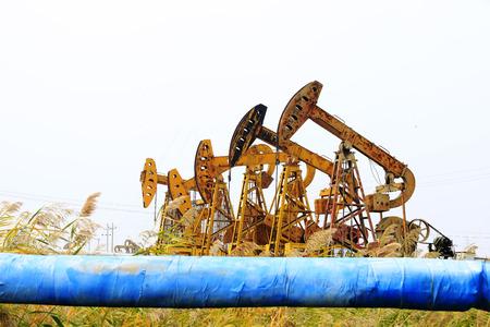 sun energy: oil pump  Stock Photo